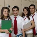 High School Students Beside School Lockers — Stock Photo #21973325