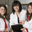 High School Students With Professor In Chemistry Lab — Foto Stock