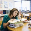 Foto Stock: Female Student Studying In Library