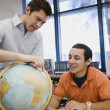 Professor Pointing Out Location On Globe To Student — Stock Photo