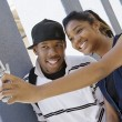 Stock Photo: High School Couple Taking Self Portrait