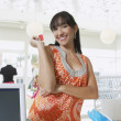 Woman With Credit Card At Counter - Stock Photo