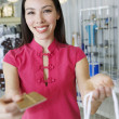 Young Woman Making A Purchase - Stock Photo
