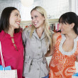 Happy Friends In Clothing Store — Stockfoto