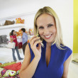 Beautiful Woman Using Cell Phone In Store — Stock Photo