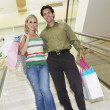 Couple With Shopping Bags On Staircase — Stock Photo
