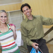 Happy Couple Carrying Shopping Bags — Stock Photo