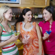 Female Friends With Drinks At Bar - Stock Photo