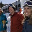 Skiers In Front Of Resort - Stock Photo