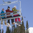 Three Skiers On Chair Lift - Stock Photo