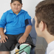 Stock Photo: Boy Having His Blood Pressure Checked