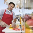 Male Street Vendor Chopping Fruits — Stock Photo #21977535