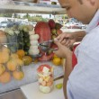Street Vendor Preparing Fruit Salad - Stock Photo