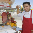 Street Vendor Standing By Stall — Stock Photo #21977557
