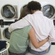 Couple Sitting At Launderette — Stock Photo
