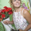 Stock Photo: Female Florist Trimming Flowers