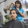 Female Hairdresser Cutting Man's Hair At Salon — Stock Photo #21977689