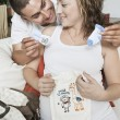 Expectant Couple With Baby Clothes — Stock Photo