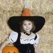 Girl In Halloween Outfit Sitting By Hay With Jack-O-Lantern — Stock Photo