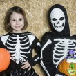 Children In Skeleton Costumes Holding Jack-O-Lanterns — Stock Photo
