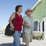 Senior Couple Walking Arm In Arm — Stock Photo