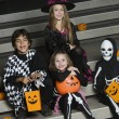 Kids Wearing Halloween Costumes On Steps — Stock Photo