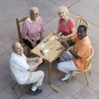 Happy Senior Friends Playing Cards — Stock Photo