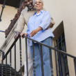 African American Couple Standing On Stairs — Stock Photo