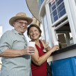 Senior Couple Buying Drinks At Food Stand — Stock Photo
