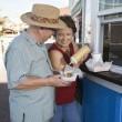 Senior Couple Eating Hot Dog — Stock Photo #21978087