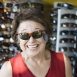 Senior Woman Trying Sunglasses At Shop — Stock Photo