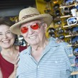 Stock Photo: Senior MTrying Sunglasses At Shop