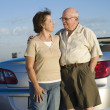 Romantic Senior Couple Standing In Front Of Car — Stock Photo