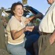 Senior Woman Is Helped Out Of A Car — Stock Photo
