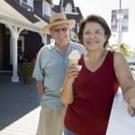 Senior Couple With Woman Holding Ice-Cream — Stock Photo