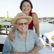 Portrait Of A Happy Senior Couple At Harbor — Stock Photo