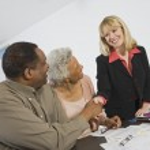 Couple Meeting Financial Advisor — Stock Photo
