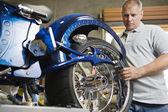 Mechanic Fixing Motorcycle — Stock Photo