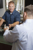 Man Paying For Repair Work — Stock Photo