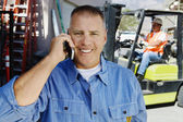 Workman Using Cell Phone — Stock Photo