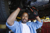 Auto Mechanic Beneath A Car — Stock Photo