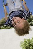 Little Boy Upside Down On A Swing — Stock Photo