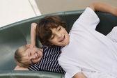 Little Boys Sliding Down A Slide — Stock Photo