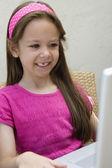 Happy Girl Using Laptop — Stock Photo