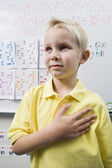 Schoolboy With His Hand Over Heart — Stock Photo
