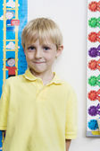 Little Boy Measuring Height In Classroom — Stock Photo