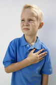 Boy With Hand On Heart — Stock Photo