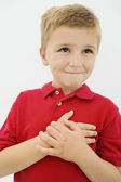 Little Boy With Hand On Heart — Stock Photo