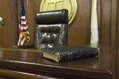 Bible And Chair In Courtroom — Stock Photo