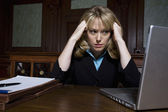 Female Lawyer Using Laptop In Courtroom — Stock Photo